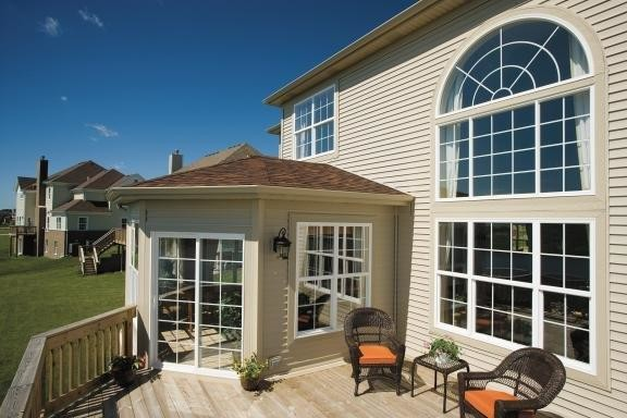 Pella Corporation Deck Contemporary with Circle Head Double Hungs