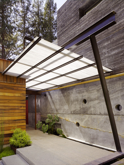 Polygal Entry Contemporary with Bamboo Pole Concrete Walls