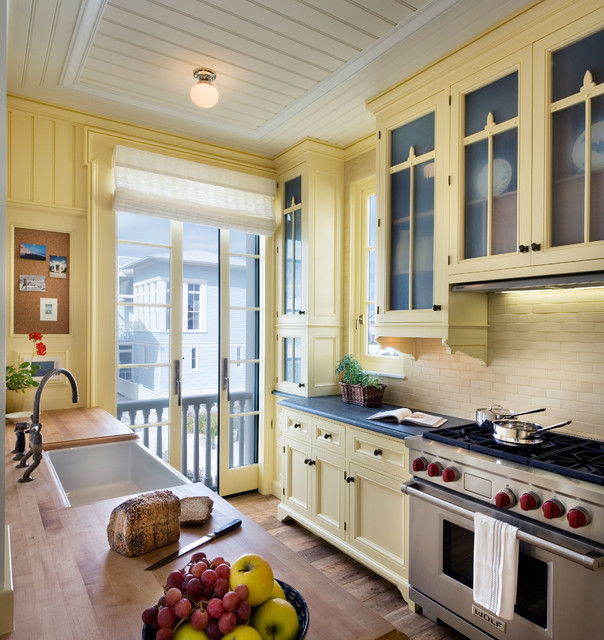 Pratt and Larson Kitchen Beach with Beadboard Ceiling Black Countertop