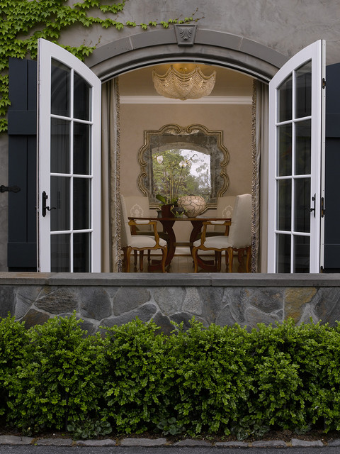 Quatrefoil Mirror Dining Room Traditional with Arch Doorway Boxwood Landscaping