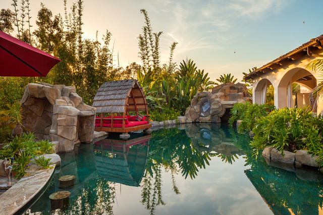 Quonset Hut Homes Pool Tropical with Balinese Oasis Bamboo Boulders
