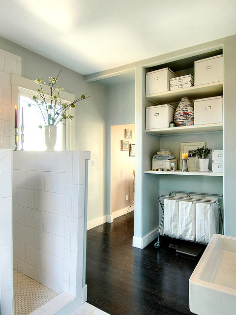 rolling laundry cart Bathroom Contemporary with dark stained wood floor