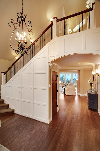 stair balusters Staircase Traditional with archway chandelier closet under