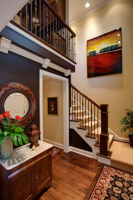 stair balusters Staircase Traditional with beige wall black patterned