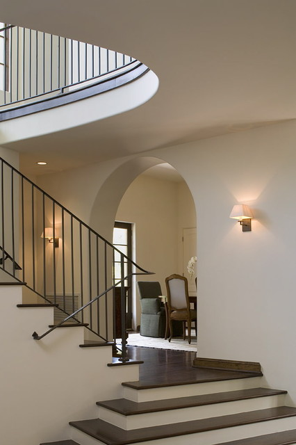 stair railings Staircase Traditional with arched doorway banister dark