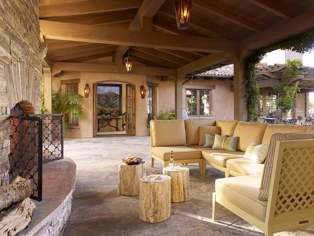 Tree Stump Table Patio Southwestern with Arch Doors Brick Fireplace