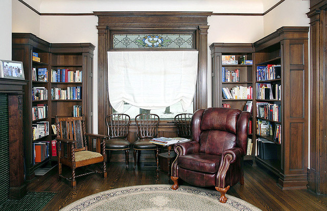 wall mounted bookshelves Living Room with red leather chair wall