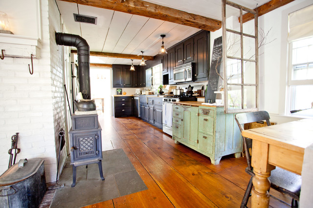 Wide Plank Flooring Kitchen Farmhouse with Brick Walls Ceiling Beams