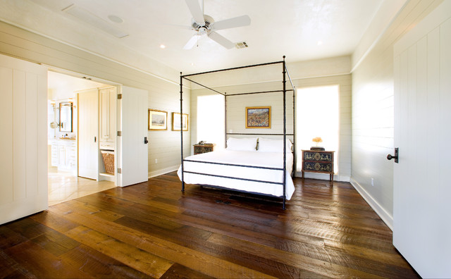 wide plank hardwood flooring Bedroom Rustic with baseboards bedside table canopy