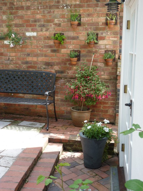 Wrought Iron Bench Patio Traditional with Contemporary Planting Cottage Garden