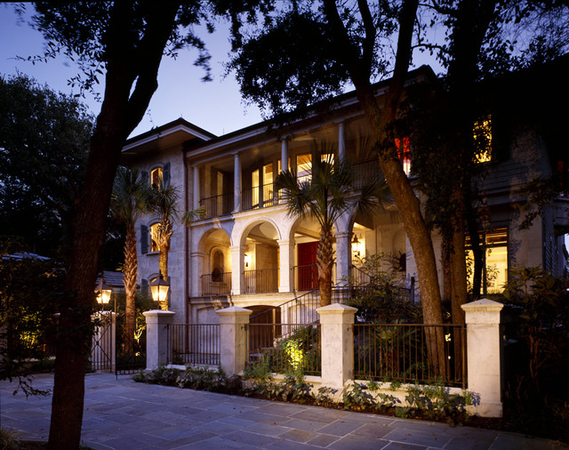 wrought iron fencing Exterior Mediterranean with arch balcony column covered