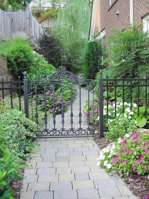 Wrought Iron Fencing Landscape Traditional with Brick Siding Concrete Flowers