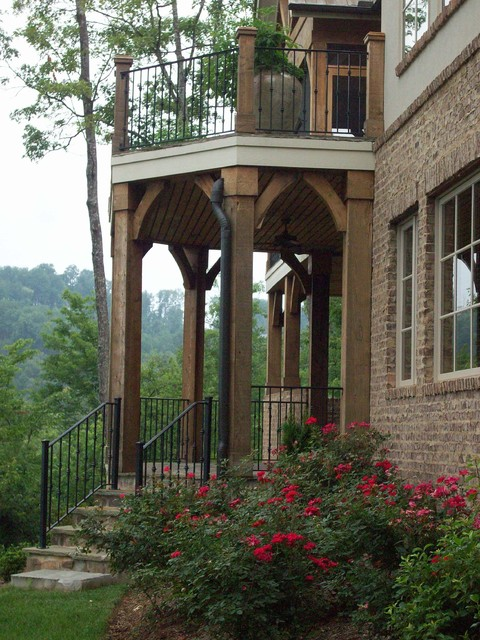 Wrought Iron Railing Exterior Traditional with Arches Balcony Brick Foundation
