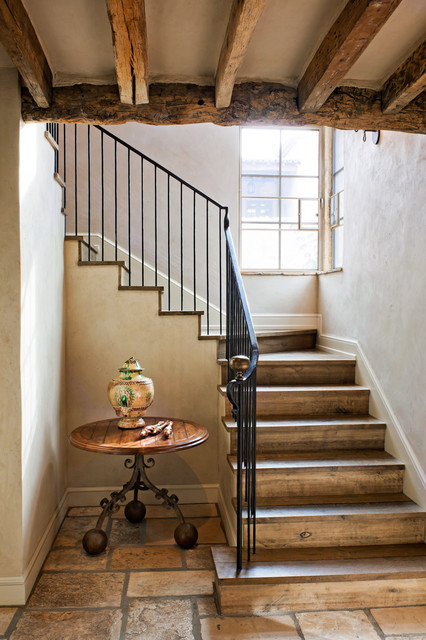 Wrought Iron Railing Staircase Rustic with Baseboards Corner Windows Curved