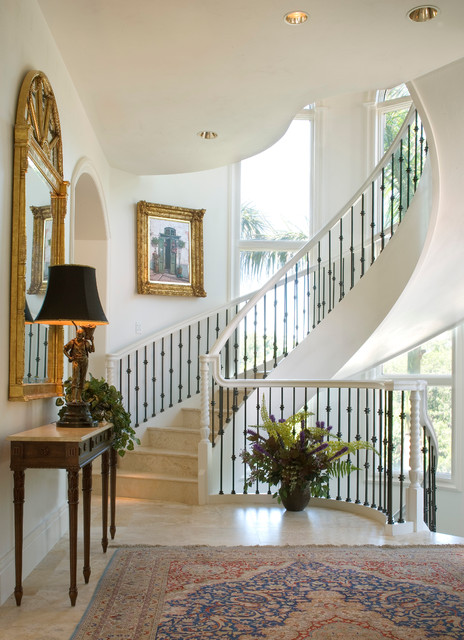 Wrought Iron Spindles Staircase Mediterranean with Beige Stone Floor Columns