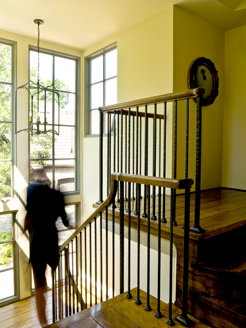 wrought iron spindles Staircase Traditional with floor-to-ceiling windows iron banister
