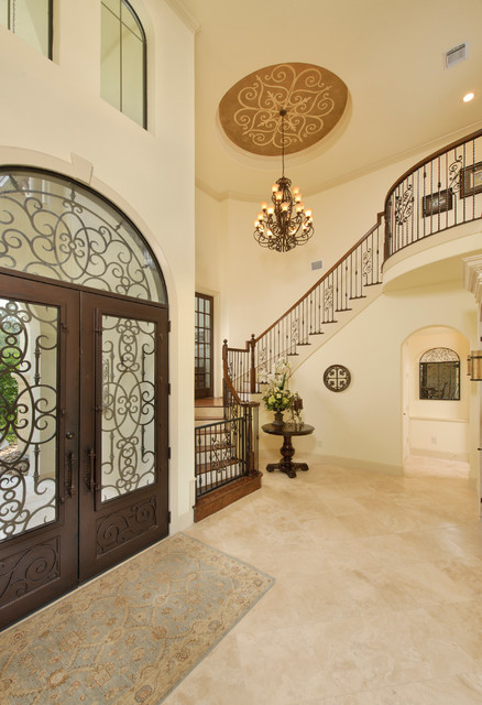 wrought iron stair railing Entry Traditional with arched doorway arched window