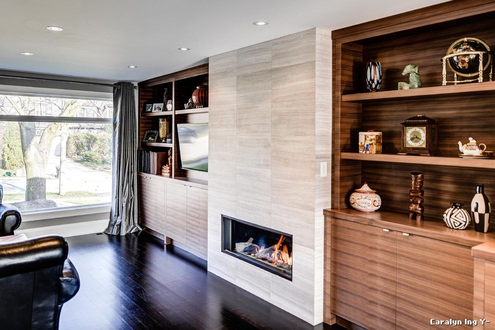Build in Bookshelves Dark Wood Fireplace  for Contemporary Family Room and General Contractor