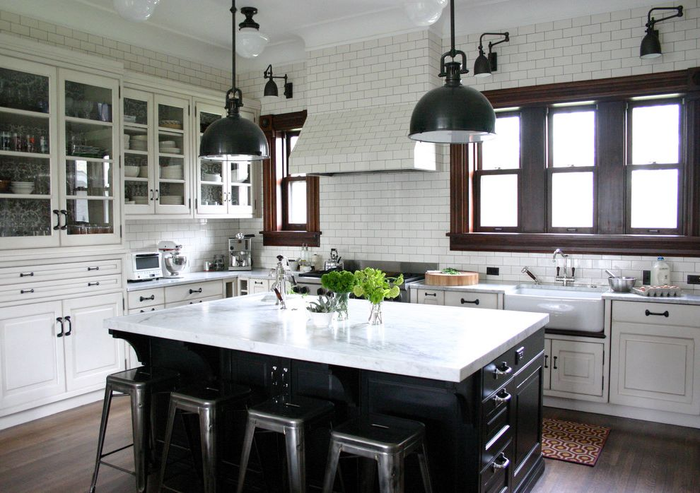 Types of Cabinets That Go with Delicatus Granite with Black Lines for Traditional Kitchen and Sconces