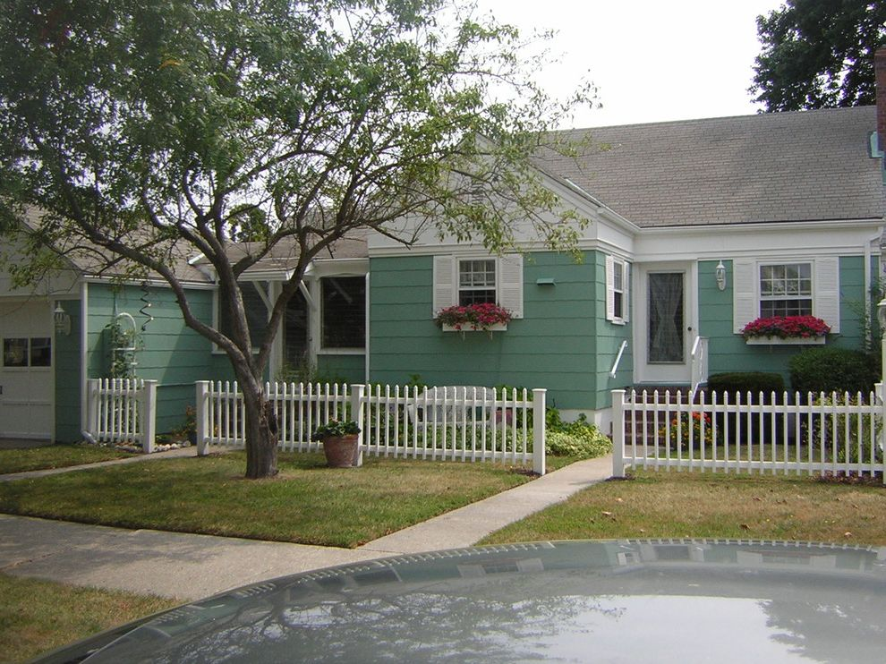 Asbestos Exterior of a Rancher House Painted Green and White in Cape May, Nj Exterior Home Color Schemes for Craftsman Exterior Exterior Photos Corrugated Metal Roofing