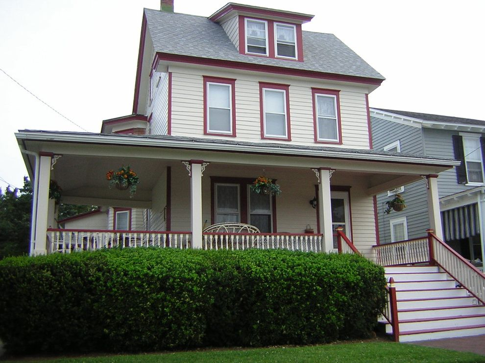 Cream and Red Exterior House Painting in Wildwood, NJ Exterior Home Color Schemes for Traditional Exterior Exterior Photos Exterior and Siding Contractors
